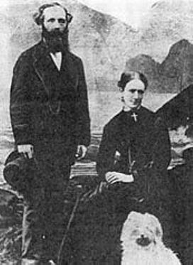 Maxwell, with his wife Katherine and their dog.