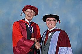 Owen Spencer-Thomas receives his doctorate from Professor Geoff Petts, Vice-Chancellor of the University of Westminster